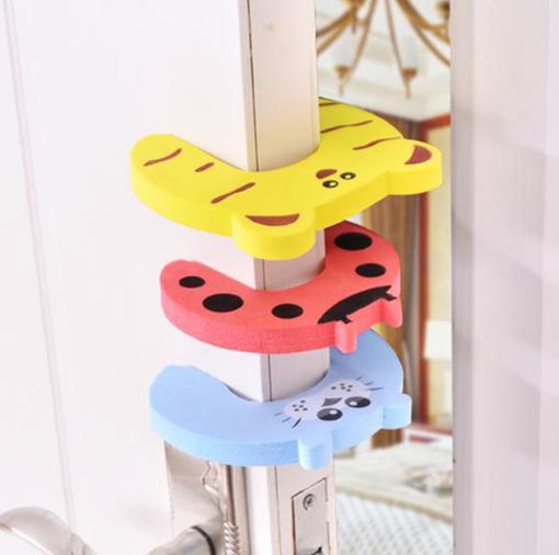 Imagen de 3 pack de topes de goma para las puertas con figuras de animalitos